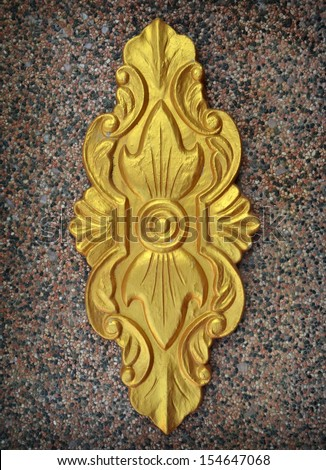 golden stone carving - stock photo