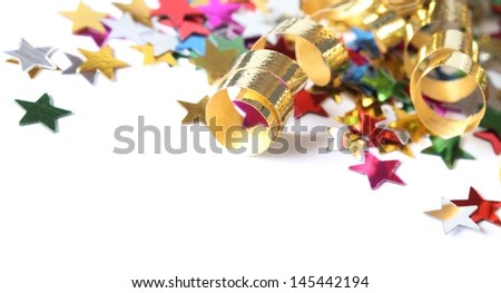 Golden streamers and confetti stars on white background. - stock photo