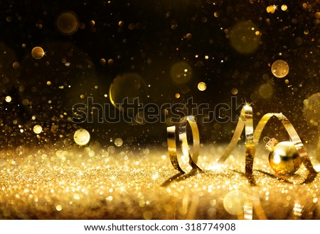 Golden Streamers With Sparkling Glitter - Christmas Holidays Background - stock photo