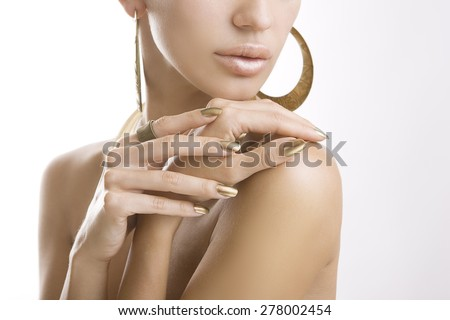 Golden Stylish Manicure, Female Hands with Shiny Golden Nail Polish. Makeup, fashion, beauty - stock photo