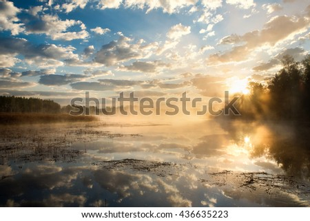 sunrise with clouds over water water sun stock images royalty free images vectors shutterstock