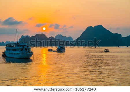 Golden sunset in Halong Bay, Vietnam, Southeast Asia - stock photo