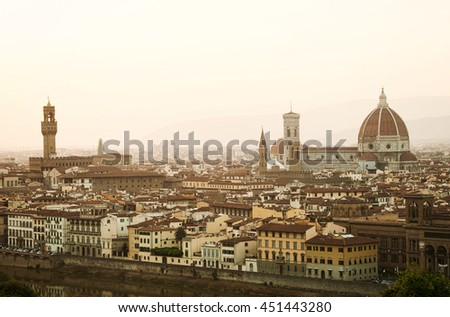 Golden sunset of Palazzo Vecchio and Cathedral of Santa Maria del Fiore, Florence, Italy.