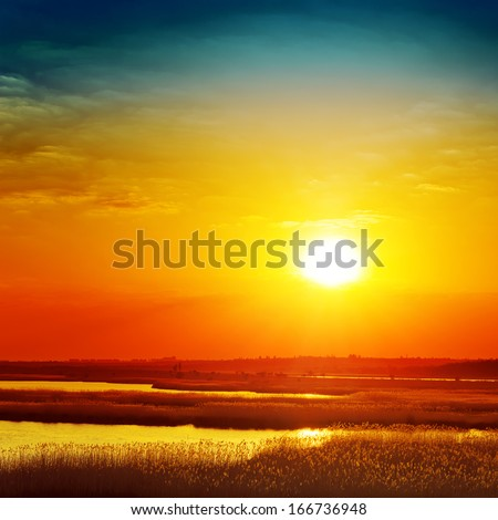 golden sunset over river - stock photo
