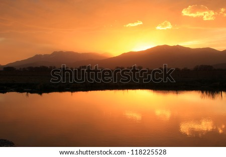 Golden sunset reflection in the Utah mountains, USA. - stock photo