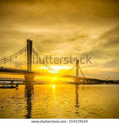 golden Sunset silhouette Bridge - stock photo