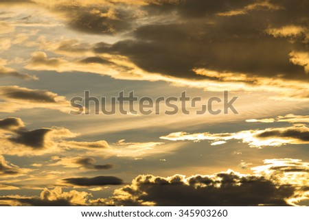 golden sunset sky and glowing cloud, twilight sky before rain storm weather background