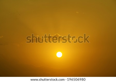 Golden sunset with clouds in Pushkar, india - stock photo