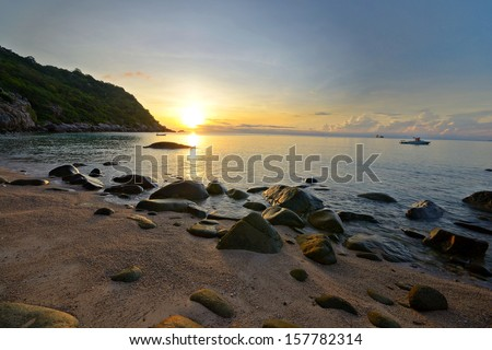 Golden surise on the tropical beach of Ao Leuk, south east of Koh Tao island, Southern Thailand  - stock photo