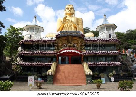 Golden temple and big Buddha in Dambulla, Sri Lanka - stock photo