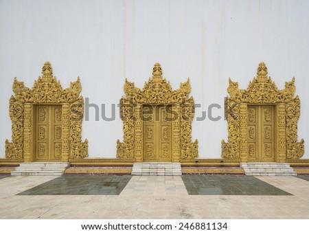 Golden temple doors made ??of wood. - stock photo