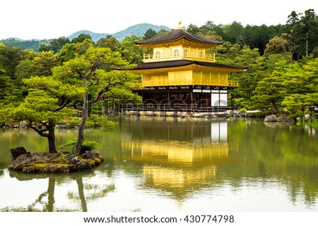 Golden temple kinkakuji castle on middle lake, Japan.