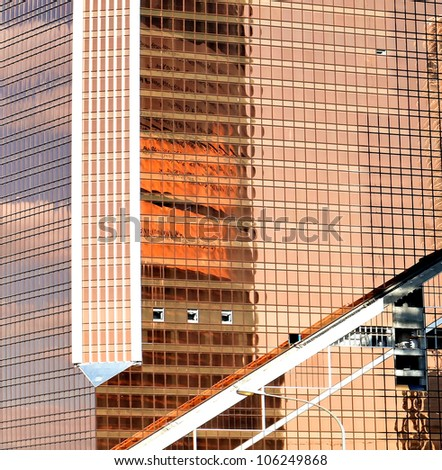 golden texture of glass transparent skyscrapers, reddish-yellow background - stock photo
