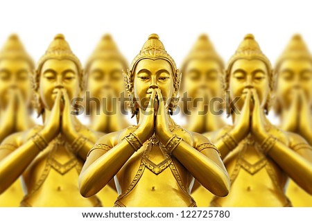Golden Thai style statues acting Wai or Sawasdee - Thai greeting and farewell manner - stock photo