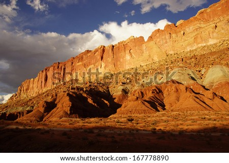 Golden Throne, dramatic backlighting with thunder clouds in background, Capitol Reef National Park, Utah