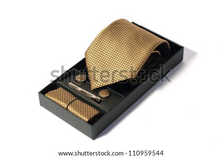 golden tie in open box - stock photo