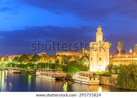 Golden Tower (Torre del Oro) of Seville, Andalusia, Spain over river Guadalquivir at sunset - stock photo
