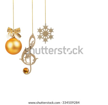 Golden treble clef, snowflake and Christmas ball isolated on white background  - stock photo