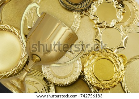 stock-photo-golden-trophy-cup-on-medals-