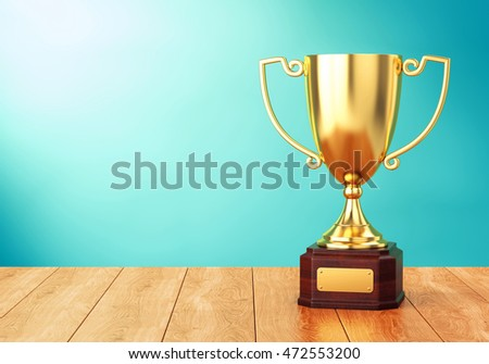 Golden trophy cup on wood table over blue wall. 3D illustration of sports award goblet