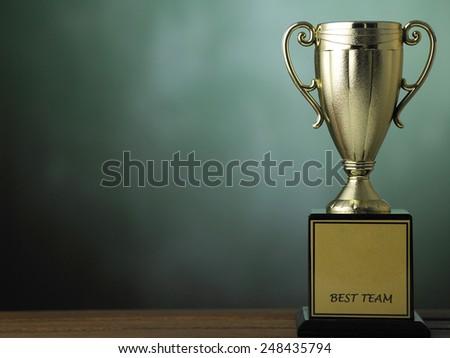 golden trophy is an achievement - stock photo