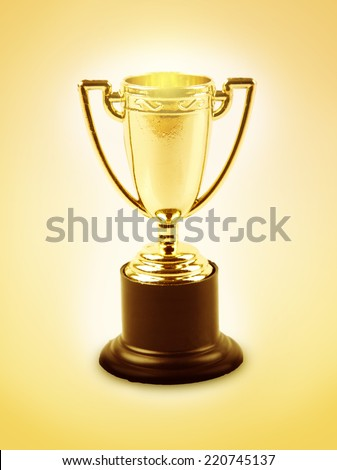 Golden trophy on orange background