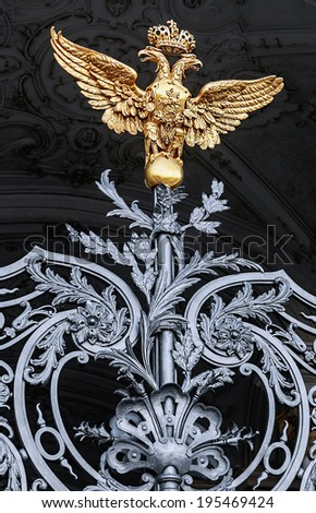 Golden two-headed eagle on Winter Palace gates. St. Petersburg, Russia - stock photo