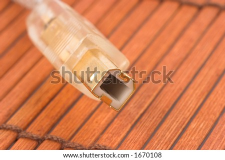 Golden USB port on brown background - stock photo
