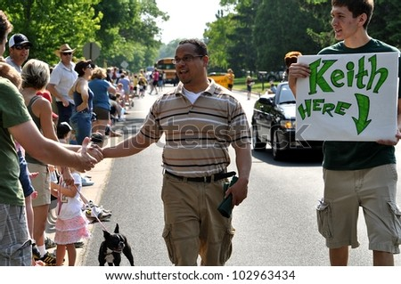 GOLDEN VALLEY, MN. - MAY 19:  Congressman Keith Ellison greets parade spectators at the Golden Valley Days Parade on May 19, 2012 in Golden Valley, Minnesota. - stock photo