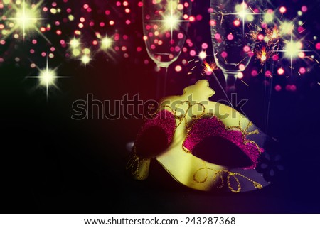 Golden venetian mask over black background. - stock photo