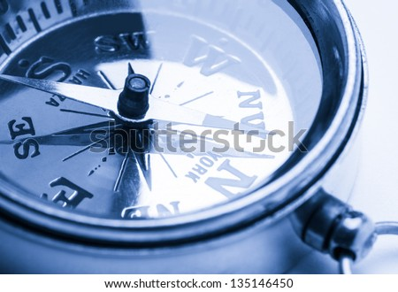 Golden vintage compass in toning - stock photo