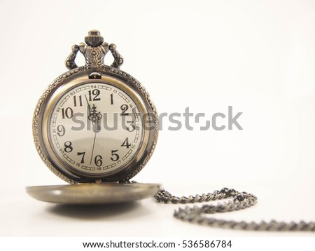 Golden vintage pocket watch with chain on warm tone background.Time concept. Copy space.