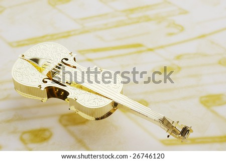 Golden violin on music note background - stock photo