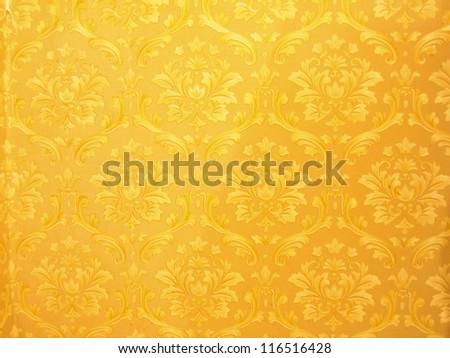 Golden wallpaper texture. - stock photo