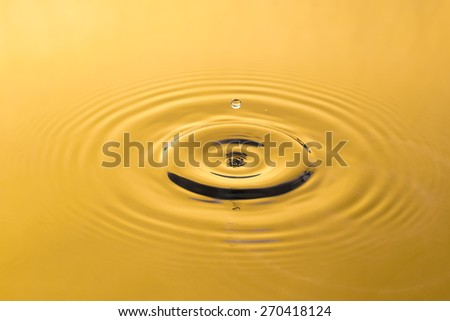golden water and water drop for background - stock photo