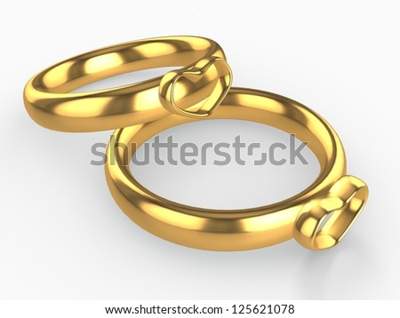 Golden wedding rings with heart. Love concept - stock photo