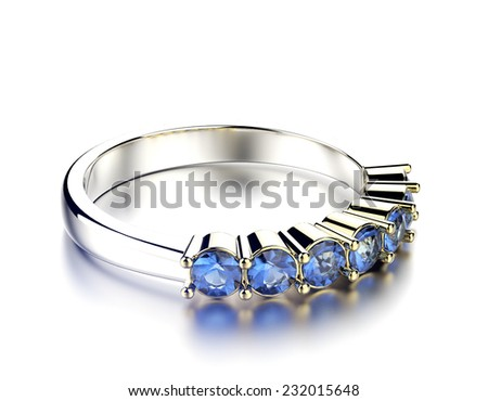 Golden wedding Rings with sapphire. Jewelry background - stock photo