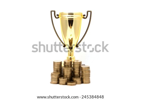 golden winner cup and coins on white background. - stock photo