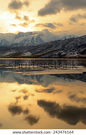 Golden winter sunset in the Utah mountains. - stock photo