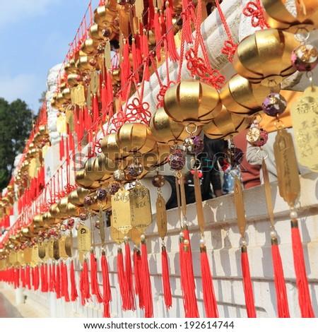 Golden wishing chimes - stock photo