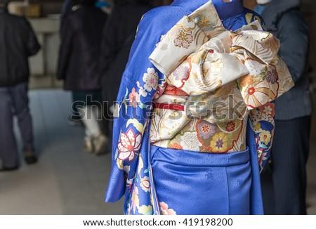 Golden Women Japanese Kimono Obi on Blue Kimono - stock photo