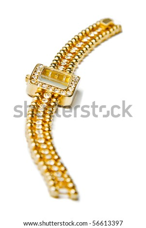 Golden wristwatch with gems isolated over white - stock photo