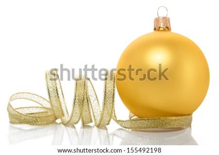 Golden xmas ball and ribbon on the white - stock photo
