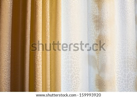 golden-yellow coloured curtains over white - stock photo