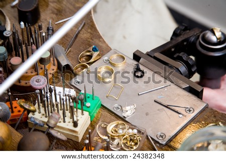 Goldsmith tools on the goldsmith workplace, desktop - stock photo