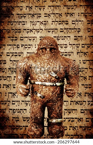 Golem statue and Hebrew text composite - stock photo