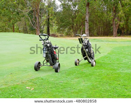Golf bags and golf clubs in golf course