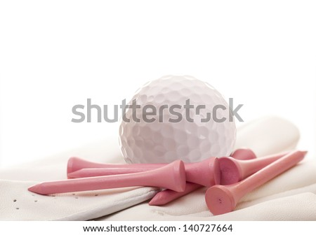 Golf Ball and Glove with Pink Tees Isolated - stock photo