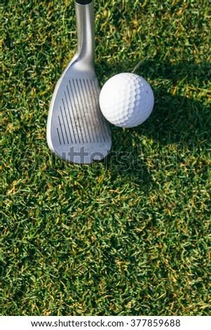 Golf ball and golf club - stock photo