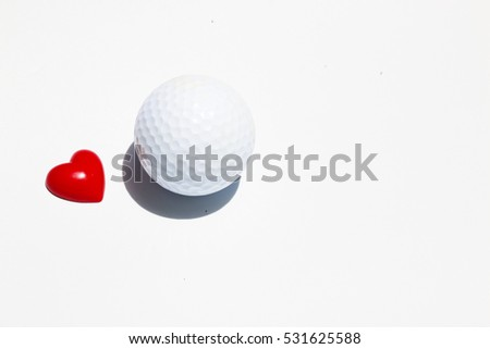 Golf ball and heart on white background